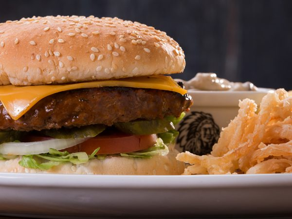 Cheddamelt Burger with chips served at Spur