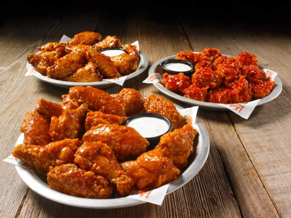 Enjoy Daytona wings with the happy hour specials at Hooters.