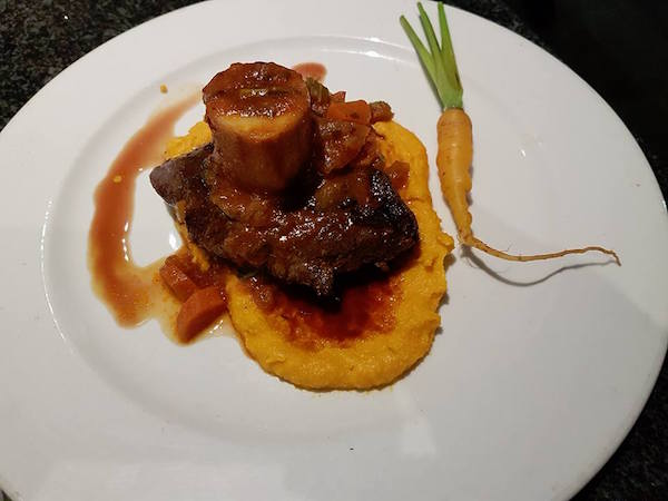 Grilled Fillet of Ostrich, Osso Buco Marrow Bone, Carrot Polenta at Luca's Ristorante Italiano