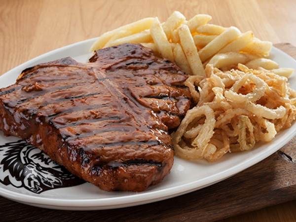 T Bone steak and sides served at Spur