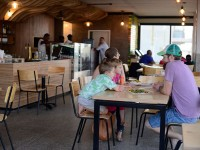 family dining inside at Surf Riders