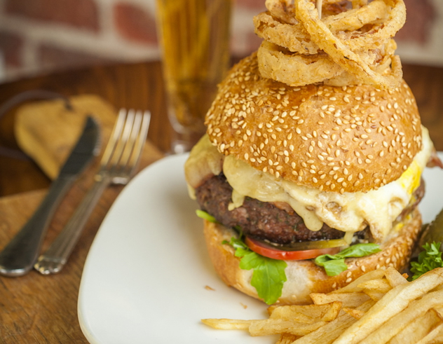 A burger and onion rings at The Odyssey. Photo courtesy of the restaurant.