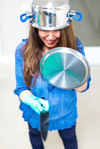 Jemima prepares to do battle in the kitchen. (Honestly, we have no idea what the people at iStock are thinking sometimes)