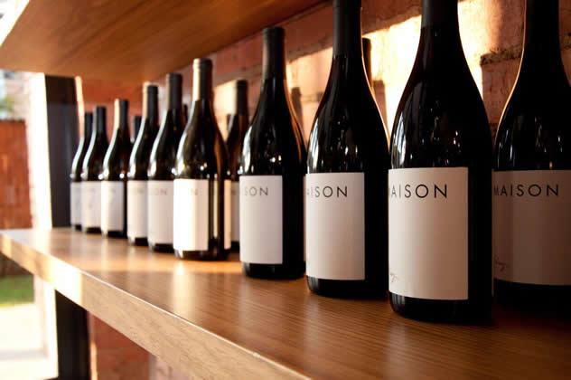 Wine bottles on a shelf at The Kitchen at Weylandts Kramerville. Photo courtesy of the restaurant.