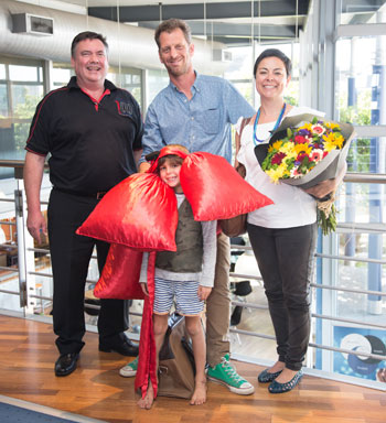 Jacques Theart, sales manager, poses with Luke Dale-Roberts, his wife Sandalene and son Findlay