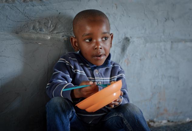 A boy enjoys his meal
