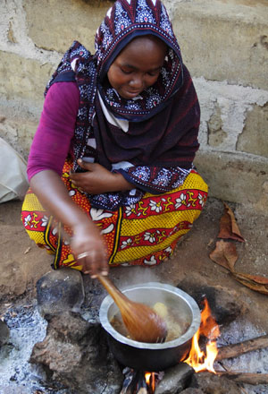 Habiba prepares pilau rice with cardamom, cinnamon bark and black pepper
