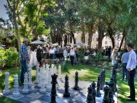 Visitors do battle with a chess set