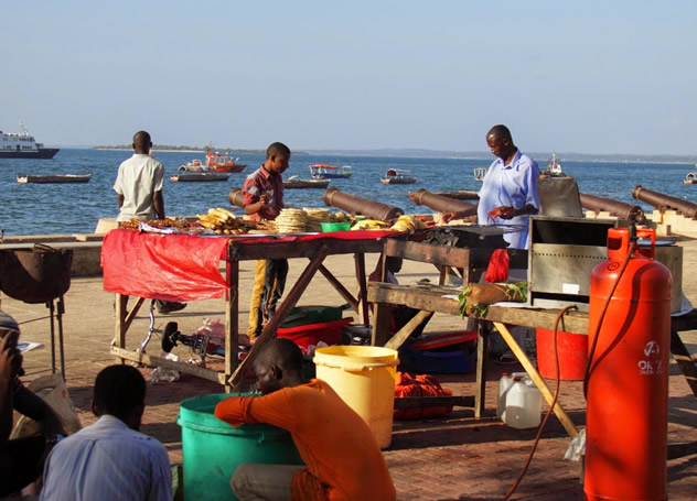 raders prepare their stalls for the Forodhani Night Market in Stone Town