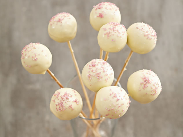 Red velvet cake pops with white chocolate jackets