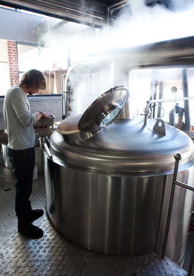 Head brewer Dewald Goosen squeezes in a brew between loadshedding at the new Woodstock Brewery, beneath The Local Grill.