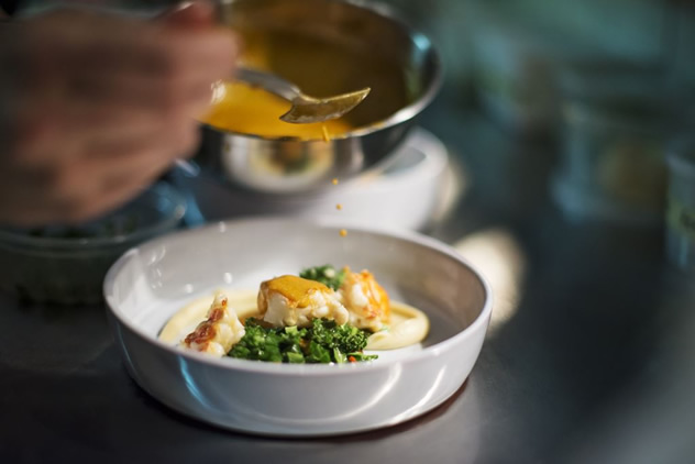 A dish being plated at Open Door. Photo courtesy of the restaurant.