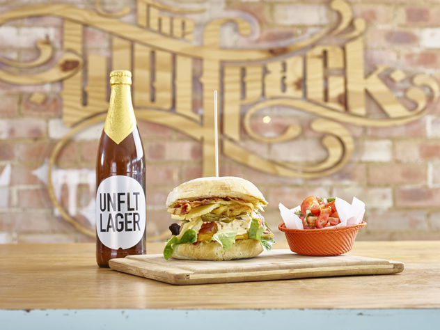 A beer and burger at The Wolfpack in Sandton. Photo courtesy of the restaurant.