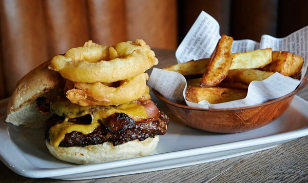 A burger with potato wedges. Photo courtesy of the restaurant.