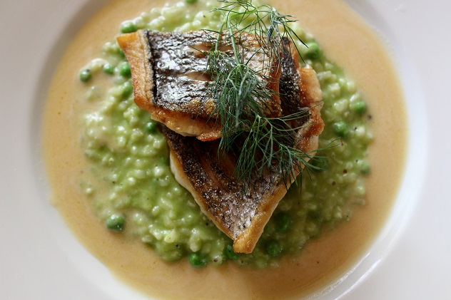 Karoux fresh fish with pea risotto & lemon beurre blanc. Photo courtesy of restaurant.