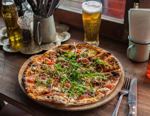A pizza and a beer at Tiger's Milk Long Street. Photo courtesy of the restaurant.
