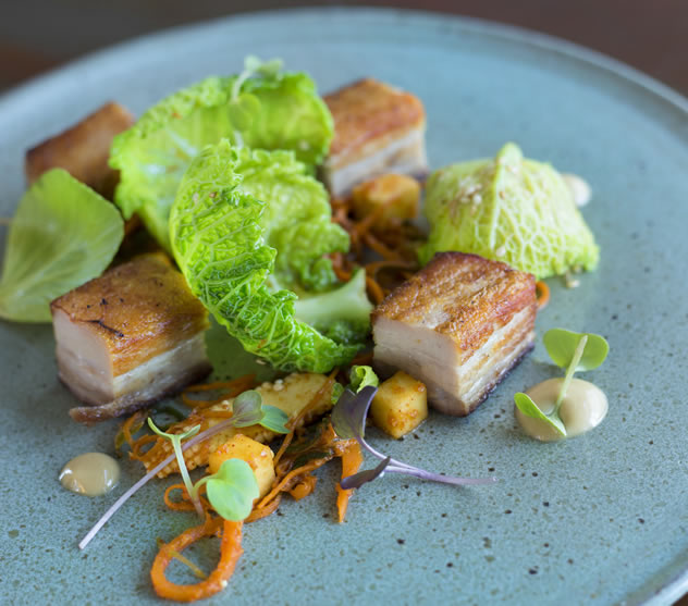 Smoked pork belly with kimchi apple and sesame mayo at The Pot Luck Club. Photo courtesy of the restaurant.