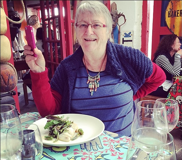 The Mother with her dish at Oep Ve Koep. Photo courtesy of Kate Wilson.