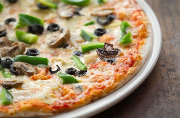 A pizza topped with pepper, mushrooms and olives at Al Firenze. Photo supplied.