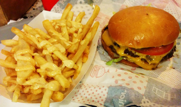 A double burger with fries with Junior sauce