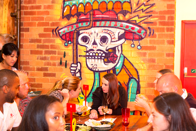 A table feasting on their burritos at Four15. Photo courtesy of the restaurant.