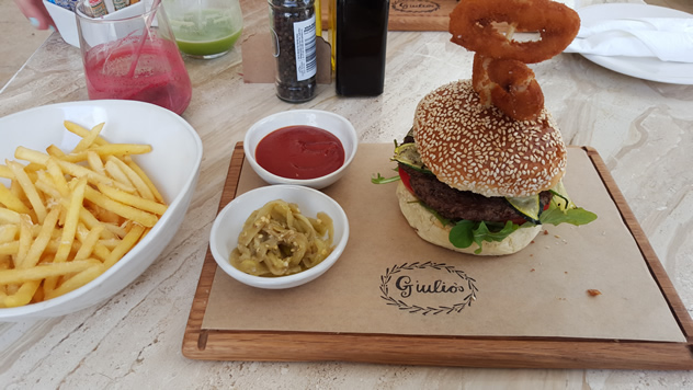 A burger with chips and onions at Giulio's Cafe. Photo courtesy of Nikita Buxton