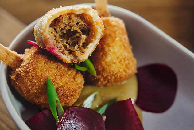 The inside of these Crumbed, deep-fried balls filled with soft, succulent duck from Bocca Restaurant. Photo courtesy of the restaurant.