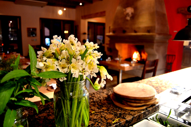 A roaring fire in the background at Foliage. Photo courtesy of the restaurant.