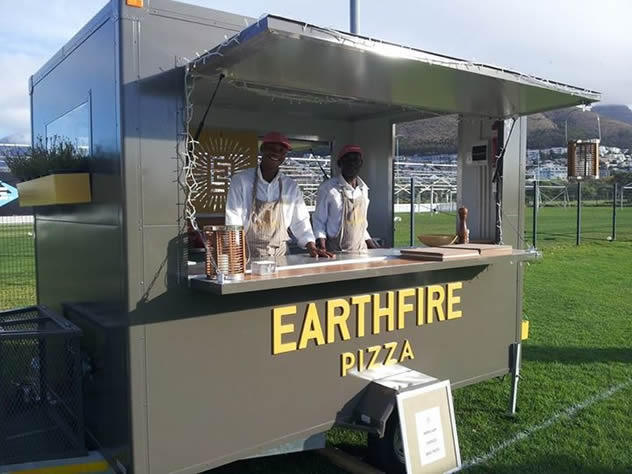 Gourmet pizzas by Earthfire Pizza food truck. Photo courtesy of the food truck.