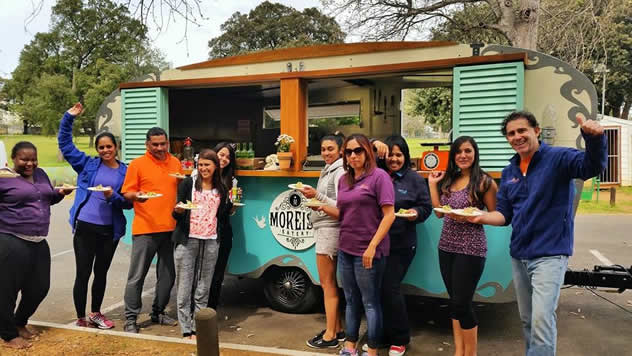 People giving the thumbs uo to Moreish Eatery food truck. Photo courtesy of the food truck.