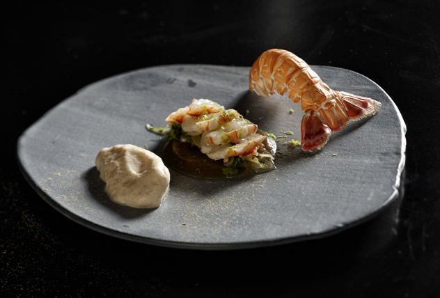 A dish of chilled blini creme, barbequed langoustine en gele, langoustine tataki and liquorice powder at The Test Kitchen. Photo courtesy of the restaurant.