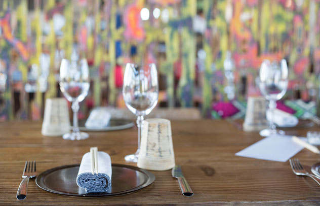 Custom-made screens divvy up the space and add a pop of colour. Photo courtesy of the restaurant.