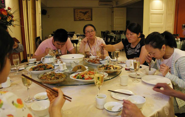 Dining family-style at Wing Hin. Photo courtesy of the restaurant.
