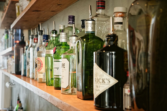 Bottles of gin on a shelf at Mother's Ruin. Photo courtesy of the restaurant.