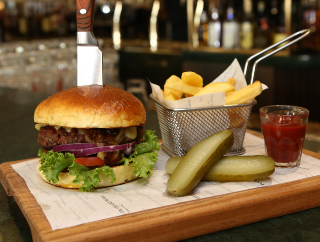 A burger, chips and pickles at Fourteen on Chartwell. Photo courtesy of the restaurant.