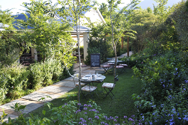The garden seating area at the River Cafe. Photo courtesy of the restaurant.