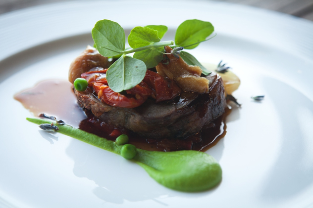 Terroir head chef Michael Broughton's lamb shoulder of certified Karoo lamb with its own juices, confit tomatoes, onions, peas and potato gratin.