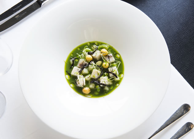 Kabeljou pickle with sultana, raw broad bean and pea, raw pea juice, and toasted nori at Five Hundred.