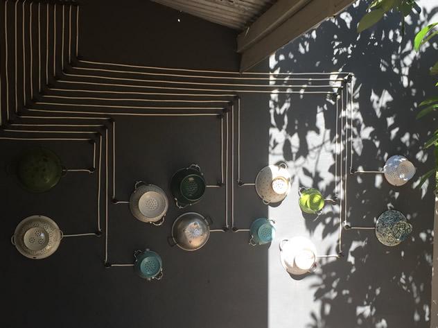 Decor of kitchenware on the walls at MyChefs Restaurant. Photo courtesy of the restaurant.