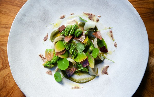 A dish of perlemoen, waterblommetjie and sour fig. Photo by Jan Ras.