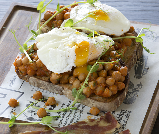 Slow-stewed chickpeas on toasted sourdough and poached eggs with tasty, crispy pancetta at Dapper Coffee Co. Photo courtesy of the restaurant.