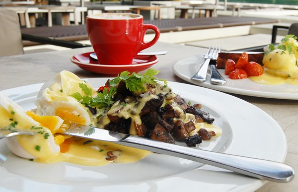 Eggs Benedict and coffee at Bistro Sixteen82. Photo supplied.