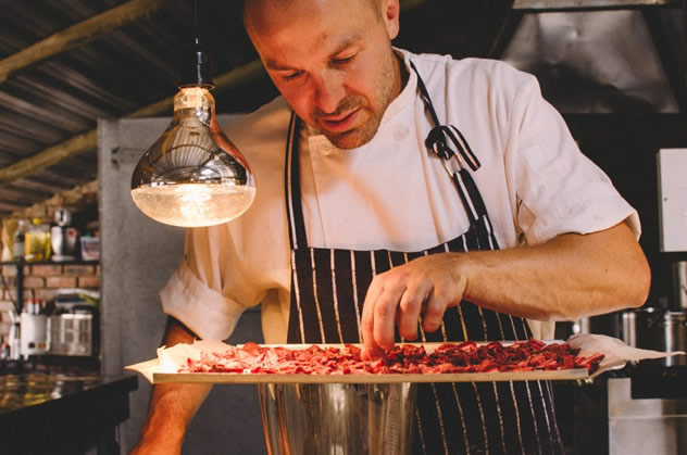 Adriaan Maree, the former Roots chef sifting through berries at Fermier. Photo courtesy of the restaurant.