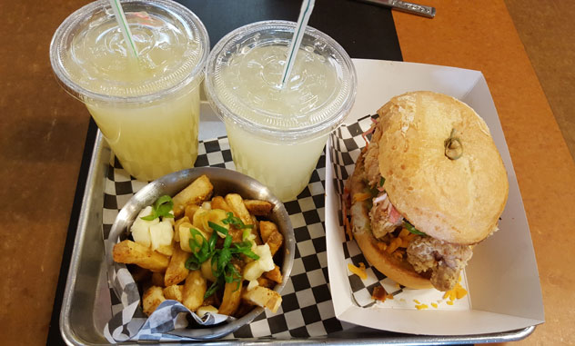 Poutine and fried chicken Sandwich at Re-Up BBQ.