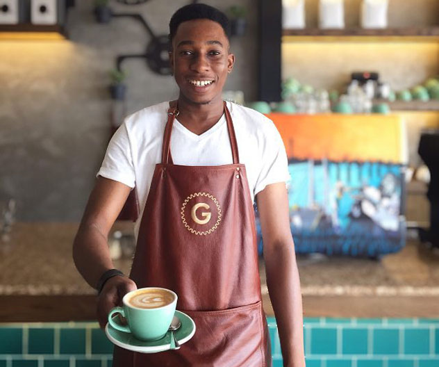One of The Grind baristas, Alfred. Photo courtesy of the cafe.