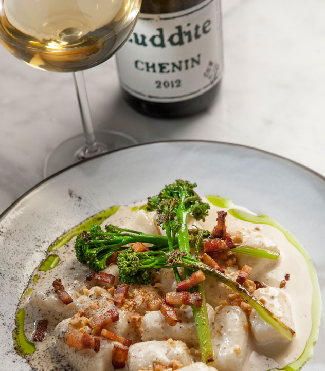 Burrata's gnocchi with gorgonzola cream, and a glass of Luddite chenin. Photo courtesy of the restaurant.
