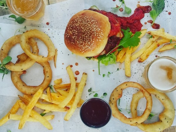 A burger onion rings and chips at Capital Craft. Photo courtesy of the restaurant.
