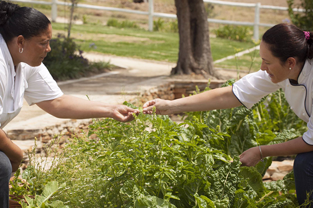 Chef Madre Malan with one of her team in the garden