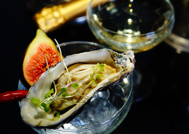 An oyster and champagne at POP in Greenside. Photo courtesy of the restaurant.