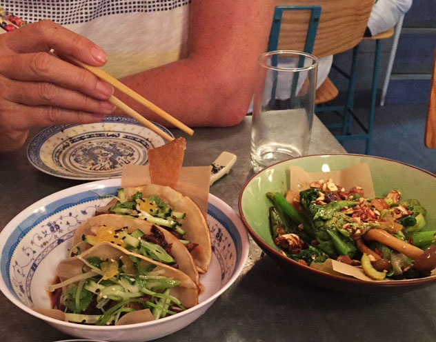 The 12-hour duck on soft ramen tacos and the vegetable surprise. Photo by Irna van Zyl.